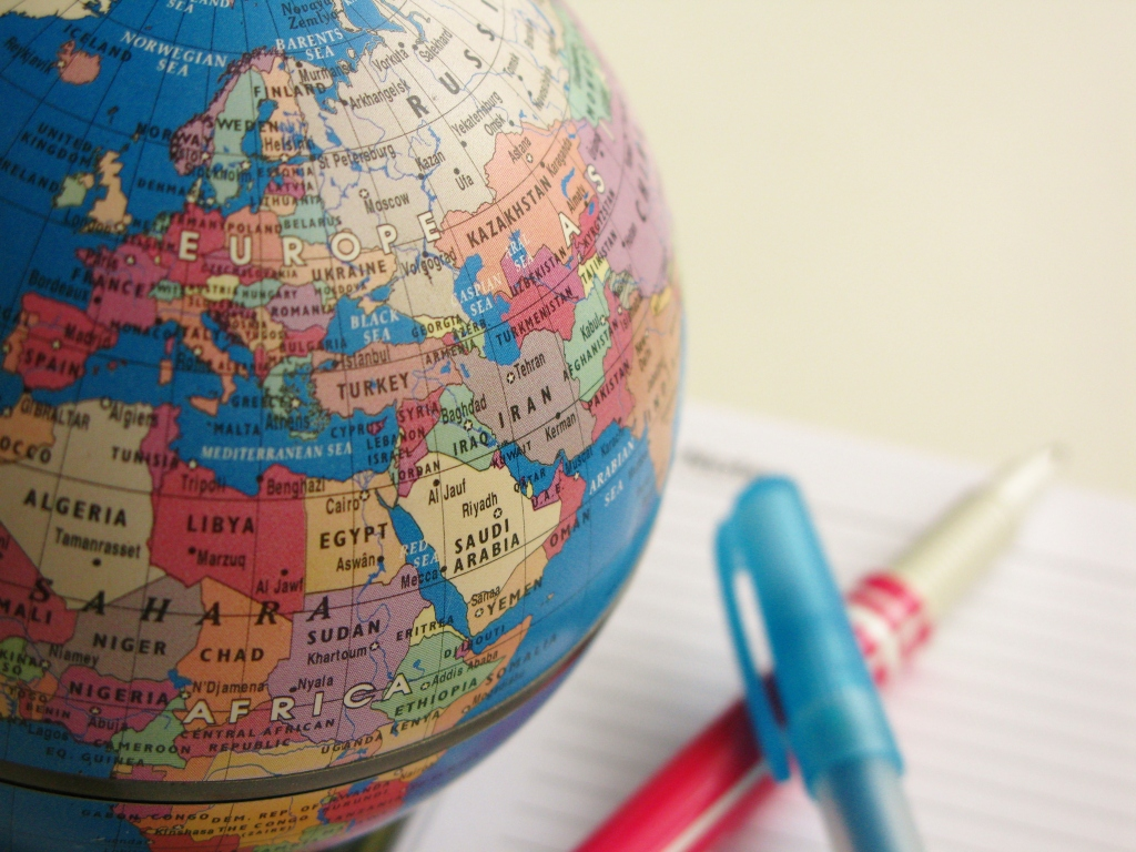 World globe with pen, highlighter and notepad