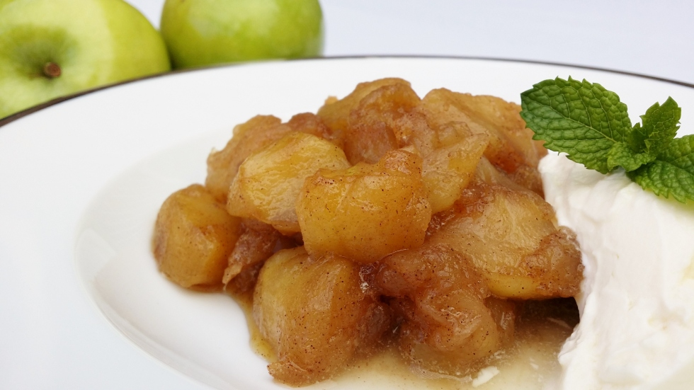Cinnamon apple dessert with yoghurt and apples in the background