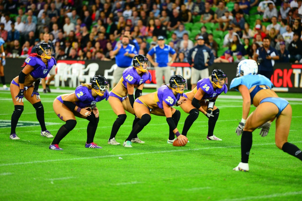 Sportswomen playing lingerie football